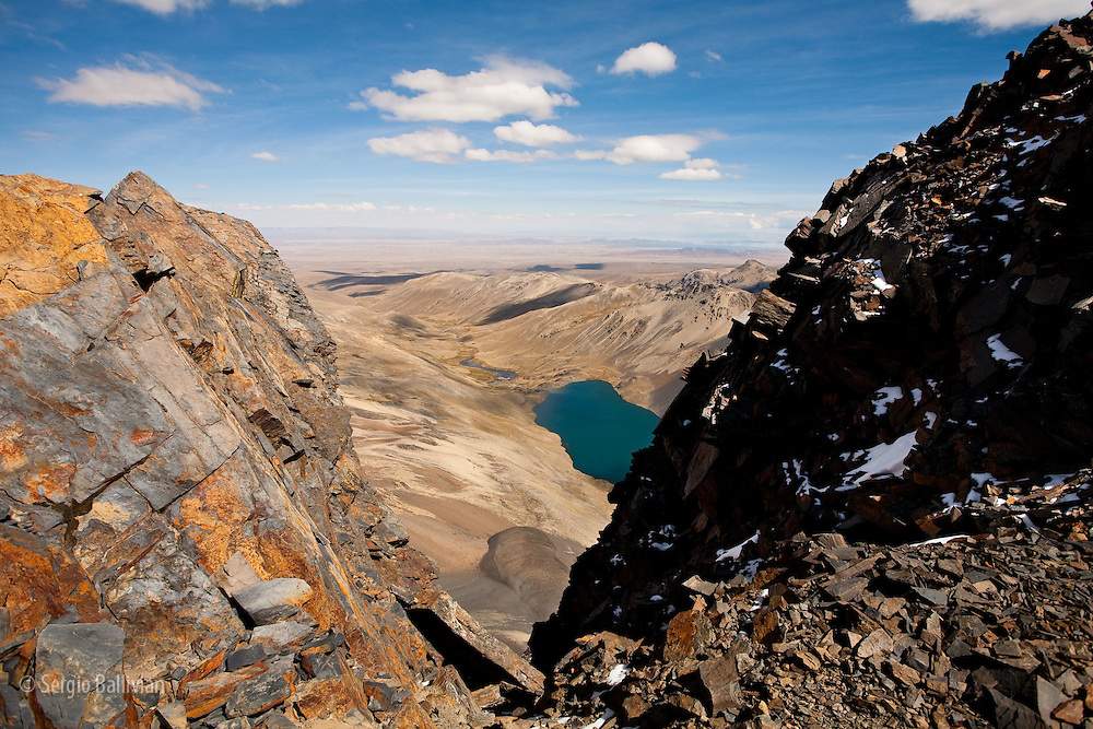 Lake Juri Khota (15,290' / 4660 m) as seen from the summit of Pico Austria (16,060' / 5200 m) in Bolivia's Cordillera Real of the Andes mountain range, looking southeast towards the Altiplano and Lake Titicaca.