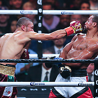 Jose Uzcategui (L) stops Andre Dirrell to win the interim super middleweight world title during the WBC Heavyweight Championship boxing match at Barclays Center on Saturday, March 3, 2018 in Brooklyn, New York. (Alex Menendez via AP)