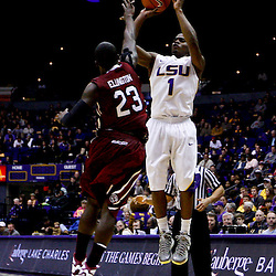 Jan 16, 2013; Baton Rouge, LA, USA; LSU Tigers guard Anthony Hickey (1) shoots over South Carolina Gamecocks guard Bruce Ellington (23) during the second half of a game at the Pete Maravich Assembly Center. South Carolina defeated LSU 82-73. Mandatory Credit: Derick E. Hingle-USA TODAY Sports