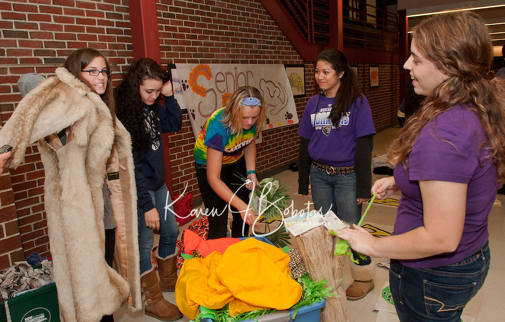 Laconia High School prep work for Homecoming Floats on September 29, 2011.