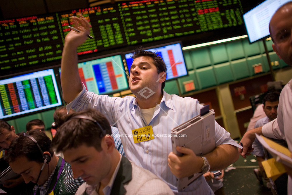 Brokers on the floor of the New York Mercantile Exchange in New York. Sept 17, 2008. .