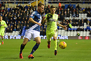Birmingham City defender Michael Morrison clears from Huddersfield Town striker Jamie Paterson during the Sky Bet Championship match between Birmingham City and Huddersfield Town at St Andrews, Birmingham, England on 5 December 2015. Photo by Alan Franklin.