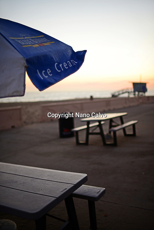 Ice Cream sign in umbrella and table in Malibu beach, California.