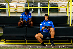 Jonson Clarke-Harris and Mark Little of Bristol Rovers read the match day programme at Burton Albion on arrival for the Sky Bet League One fixture - Mandatory by-line: Robbie Stephenson/JMP - 31/08/2019 - FOOTBALL - Pirelli Stadium - Burton upon Trent, England - Burton Albion v Bristol Rovers - Sky Bet League One