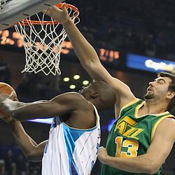 Feb 17, 2010; New Orleans, LA, USA; Utah Jazz center Mehmet Okur (13) defends against New Orleans Hornets center Emeka Okafor (50) during the first quarter at the New Orleans Arena. Mandatory Credit: Derick E. Hingle-US PRESSWIRE