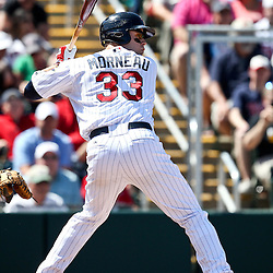 March 11, 2011; Fort Myers, FL, USA; Minnesota Twins first baseman Justin Morneau (33) during a spring training exhibition game against the Boston Red Sox at Hammond Stadium.   Mandatory Credit: Derick E. Hingle