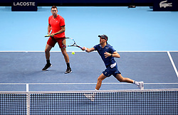 Mike Bryan (right) and Jack Sock in action during their doubles match during day seven of the Nitto ATP Finals at The O2 Arena, London.