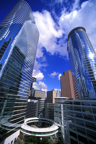 Stock photo of the former Enron buildings now known as 1500 Louisiana Street (left) and 1400 Smith Street (right). and the downtown skyline.