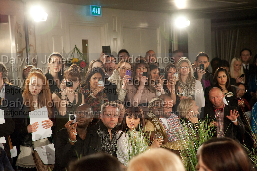 Audience with camera phones, Stephane St. Jaymes Spring Summer 2011 fashion show.<br /> The Westbury Mayfair, Bond Street, London,DO NOT ARCHIVE-© Copyright Photograph by Dafydd Jones. 248 Clapham Rd. London SW9 0PZ. Tel 0207 820 0771. www.dafjones.com.