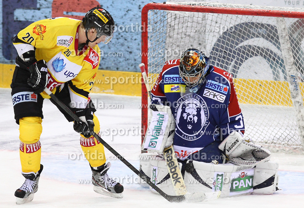 13.02.2013, Albert Schultz Eishalle, Wien, AUT, EBEL, UPC Vienna Capitals vs KHL Medvescak Zagreb, 6. Platzierungsrunde, im Bild Marcus Olsson, (UPC Vienna Capitals, #20) und Robert Kristan, (KHL Medvescak Zagreb, #33)  // during the Erste Bank Icehockey League 6th placement Round match betweeen UPC Vienna Capitals and KHL Medvescak Zagreb at the Albert Schultz Ice Arena, Vienna, Austria on 2013/02/13. EXPA Pictures © 2013, PhotoCredit: EXPA/ Thomas Haumer