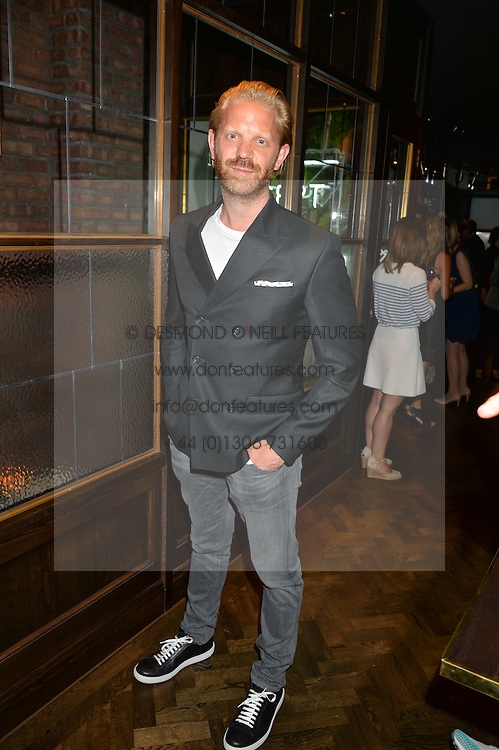 ALISTAIR GUY at a party to celebrate the launch of Sackville's Bar & Grill, 8a Sackville Street, London on 15th July 2015.