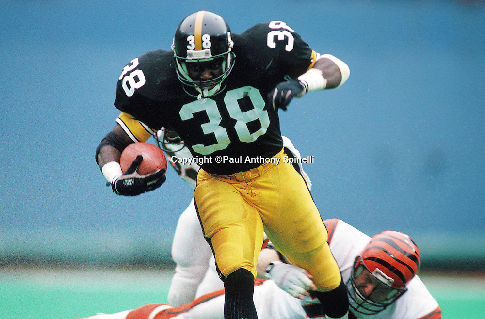 Pittsburgh Steelers running back Tim Worley (38), the Steelers first round draft pick in the 1989 NFL Draft, breaks a tackle as he runs the ball during the NFL football game against the Cincinnati Bengals on Oct. 8, 1989 in Pittsburgh. The Bengals won the game 26-16. (©Paul Anthony Spinelli)