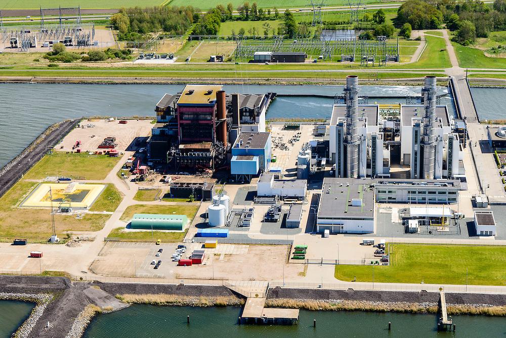 Nederland, Flevoland, Gemeente Lelystad, 07-05-2015. Maximacentrale (voorheen Flevocentrale) van Electrabel, op een eigen kunstmatig aangelegd eiland in het IJsselmeer. Twee nieuwe stoom- en gaseenheden (STEG) met aardgas als brandstof, relatief schoon en met hoog-rendement.<br /> Maxima power plant (formerly Flevocentrale) of Electrabel, on its own artificial island in the IJsselmeer. Two new steam and gas units (CCGT) with natural gas as fuel, relatively clean and high-efficiency (combined cycle units). <br /> luchtfoto (toeslag op standard tarieven);<br /> aerial photo (additional fee required);<br /> copyright foto/photo Siebe Swart