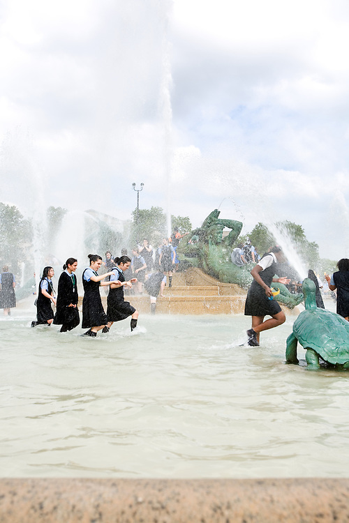 Girls from Hallahan High School underclassmen splash through Logan Square fountain in Philadelphia in order to celebrate the finish of their first year of high school.