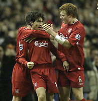 Photo: Aidan Ellis.<br /> Liverpool v Arsenal. The Barclays Premiership. 14/02/2006.<br /> Liverpool's John Arne Riise congratulates goal scorer Luis Garcia