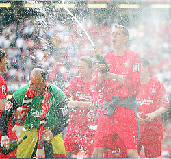 CARDIFF, WALES - SATURDAY, MAY 13th, 2006: Liverpool's Peter Crouch sprays champagne as he celebrates with his team-mates after victory over West Ham United after winning the FA Cup on penalty kicks during the FA Cup Final at the Millennium Stadium. (Pic by David Rawcliffe/Propaganda)