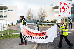 Windsor, UK. 22nd February, 2019. Around 60 campaigners from Reclaim the Power and Fuel Poverty Action arrive to set up a mock fracking site during a family-friendly protest outside the headquarters of Centrica to call on the British multinational energy and services company to cease its support for fracking operations through its partnership with shale gas company Cuadrilla Resources.