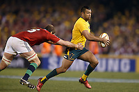 MELBOURNE, 29 JUNE - Kurtley BEALE of the Wallabies evades a tackle during the Second Test match between the Australian Wallabies and the British & Irish Lions at Etihad Stadium on 29 June 2013 in Melbourne, Australia. (Photo Sydney Low / asteriskimages.com)