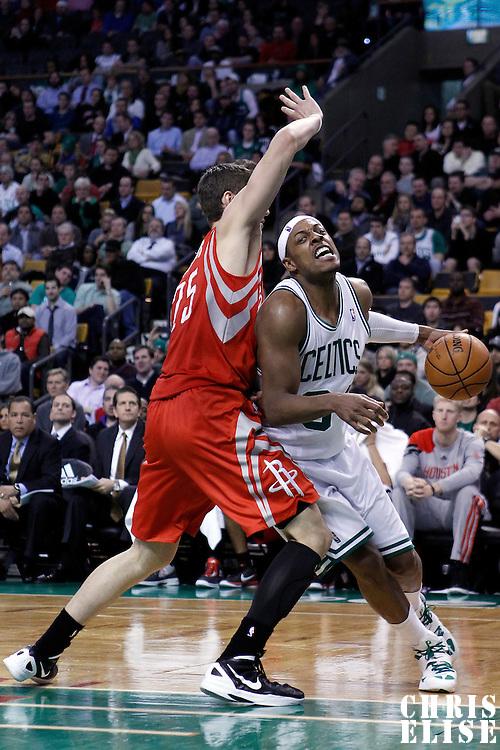 06 March 2012: Boston Celtics small forward Paul Pierce (34) drives past Houston Rockets forward Chandler Parsons (25) during the Boston Celtics 97-92 (OT) victory over the Houston Rockets at the TD Garden, Boston, Massachusetts, USA.