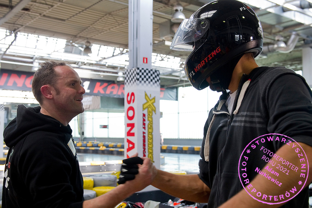 (L) Racing driver Tomasz Kuchar and (R) Jerzy Janowicz of Poland while GoKarts Racing on F1 Karting Track four days before the BNP Paribas Davis Cup 2014 between Poland and Croatia in Warsaw on March 31, 2014.<br /> <br /> Poland, Warsaw, March 31, 2014<br /> <br /> Picture also available in RAW (NEF) or TIFF format on special request.<br /> <br /> For editorial use only. Any commercial or promotional use requires permission.<br /> <br /> Mandatory credit:<br /> Photo by © Adam Nurkiewicz / Mediasport