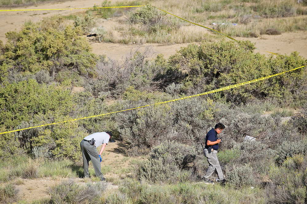 091712       Brian Leddy.Crime Scene Investigator Detectives Emery Holly and Krissy Leekity investigate a body found in the Stagecoach area.