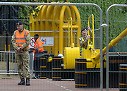 © Licensed to London News Pictures. 18/07/2012. Westminster, UK Soldier operate a barrier on The Mall. Soldiers, police and security contractors perform security checks around Olympic sites in Westminster today, 18th July 2012. Photo credit : Stephen Simpson/LNP