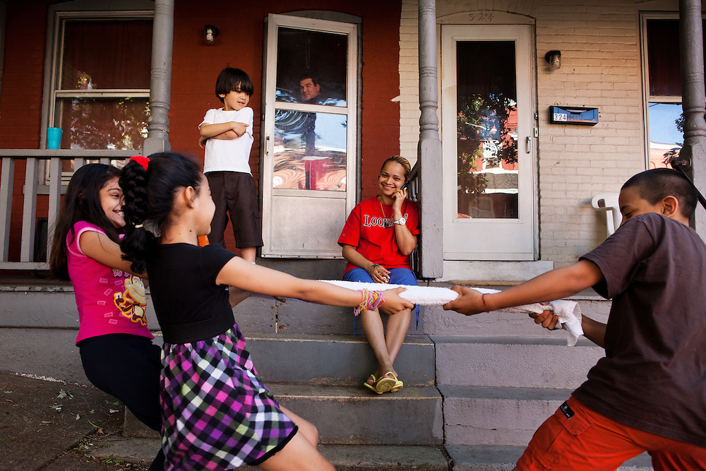 BETHLEHEM, PA – JUNE 2, 2011: Ortesia Galindo of Bethlehem, Pennsylvania watches as Pahola Acosta, age 9, Edgardo Rodriguez, age 13, Alisha Acosta, age 10, Edleoned Rodriguez, age 6, and Neida Ruedas, age 9 play outside her home on State Street in the early afternoon of June 2, 2011.<br /> <br /> As the population of second and third generation Hispanics increases dramatically in the United States, a new boldness can be sensed among Latinos in America, stretching far beyond the southern border states. Demographers in Pennsylvania say the towns of Bethlehem, Allentown and Reading are set to become majority-minority cities, where Hispanics comprise a bigger portion of the population than whites. As this minority population increases dramatically in the region, Latinos are inching closer to their own realization of the American Dream, while gradually shifting the physical and cultural landscapes of their communities.