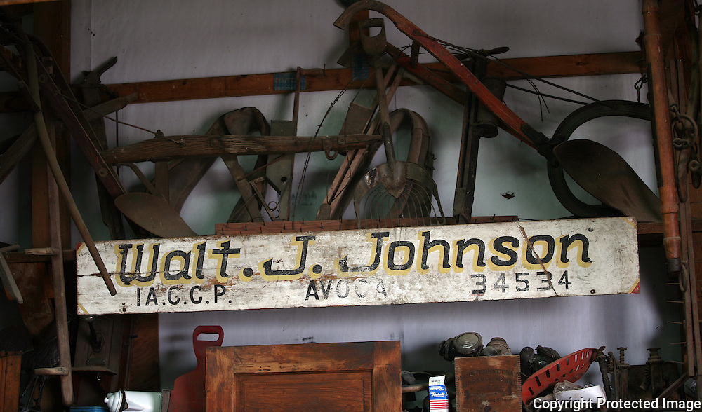 Bill Johnson's father left this old sign which went on the rack of a stock truck.  It now is one of many farm antiques which the Johnson's collect.  Photo by David Peterson