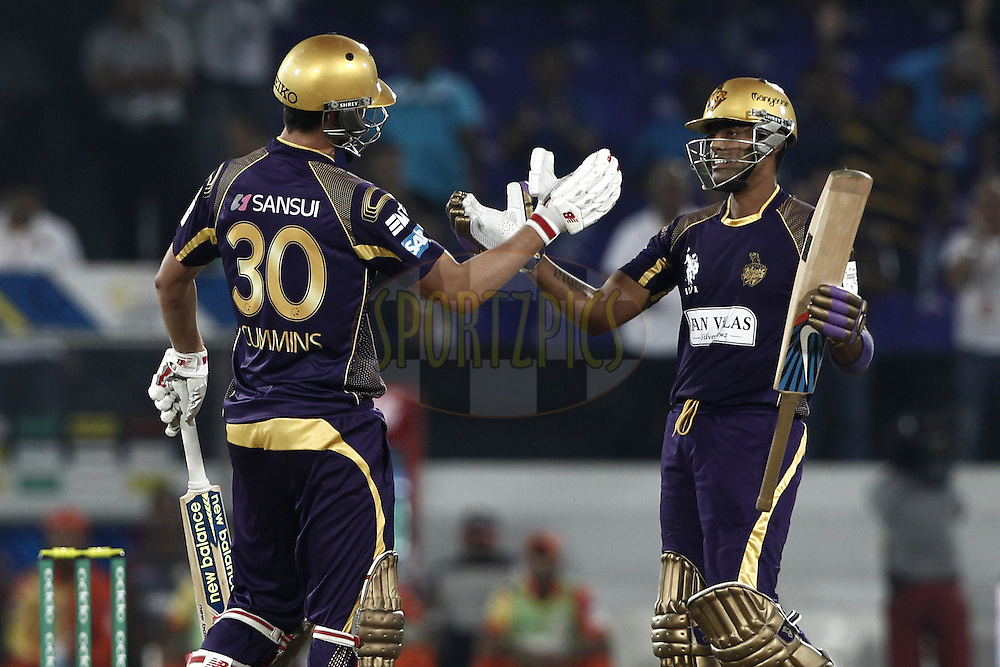 Patrick Cummins and Suryakumar Yadav of the Kolkata Knight Riders celebrates his win against the LAHORE LIONS during match 7 of the Oppo Champions League Twenty20 between the Kolkata Knight Riders and the Lahore Lions held at the Rajiv Gandhi Cricket Stadium, Hyderabad, India on the 21st September 2014<br /> <br /> Photo by:  Deepak Malik / Sportzpics/ CLT20<br /> <br /> <br /> Image use is subject to the terms and conditions as laid out by the BCCI/ CLT20.  The terms and conditions can be downloaded here:<br /> <br /> http://sportzpics.photoshelter.com/gallery/CLT20-Image-Terms-and-Conditions-2014/G0000IfNJn535VPU/C0000QhhKadWcjYs