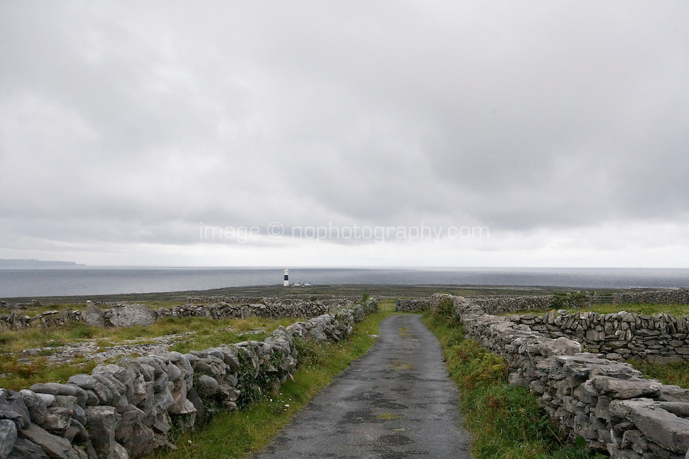 rain clouds over a small roadway on Inis Oirr Island the Aran Islands County Galway Ireland