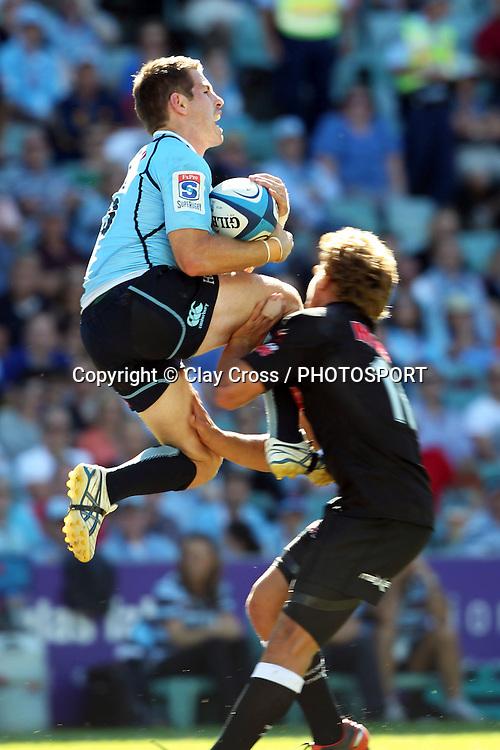 Bernard Foley hits Patrick Lambie. Waratahs v Sharks. 2012 Super Rugby round 5 match. Allianz Stadium, Sydney Australia on Saturday 24 March 2012. Photo: Clay Cross / photosport.co.nz