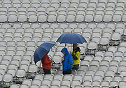Fans standing in the stand with umbrellas up as it rains ahead of play on day 3 during the International Test Match 2019, fourth test, day three match between England and Australia at Old Trafford, Manchester, England on 6 September 2019.