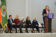 "Westbury, New York, USA. January 15, 2017. At podium, JoANN SMITH, President of Planned Parenhood Nassau County Action Fund, speaks at the ""Our First Stand"" Rally against Republicans repealing the Affordable Care Act, ACA, taking millions of people off health insurance, making massive cuts to Medicaid, and defunding Planned Parenthood. Speakers seated on stage included: (next to flag) Rep. Tom Suozzi (Dem. - 3rd Congress. Dist.), (center) Town of North Hempstead Supervisor JUDI BOSWORTH, (right of Bosworth) Kathleen Rice (Dem. - 4th Congress. District)."