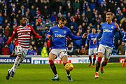 Borna Barisic of Rangers gets the ball under control while under pressure from Rakish Bingham of Hamilton Academical FC during the Ladbrokes Scottish Premiership match between Rangers and Hamilton Academical FC at Ibrox, Glasgow, Scotland on 16 December 2018.