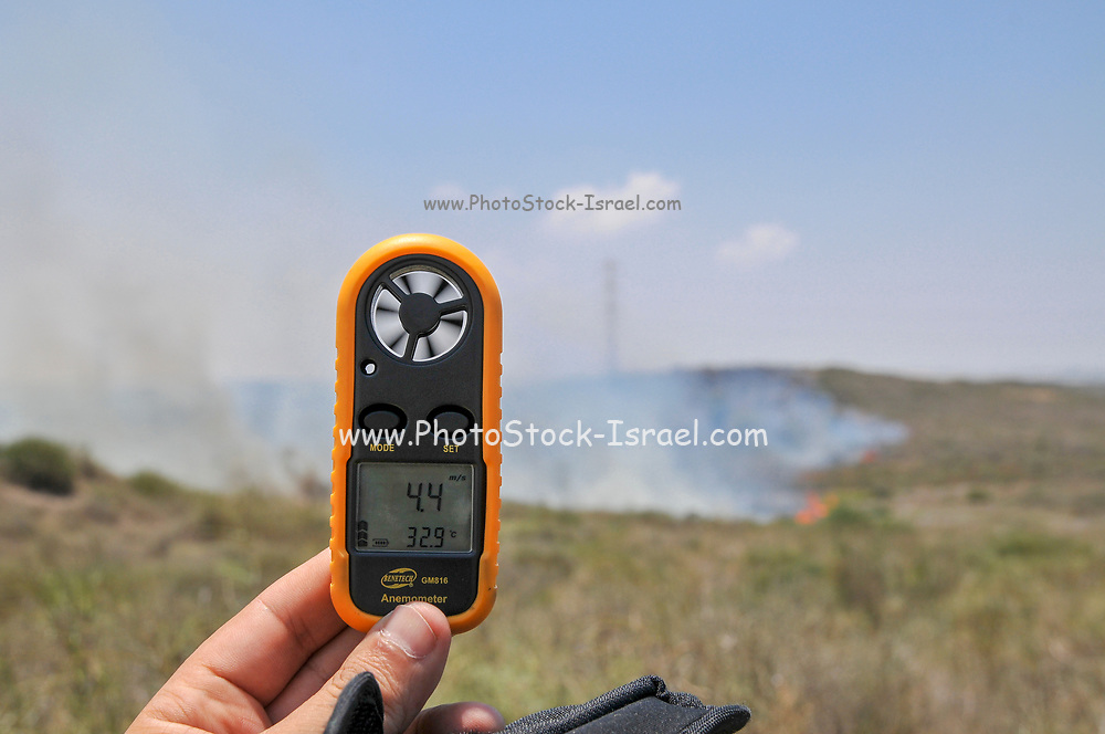 Checking the wind speed and temperature of yet another fire caused by Palestinian Kite bombs that were flown from Gaza with a lit petrol soaked cloth, to set fires to Israeli fields and crops. Photographed on July 13, 2018 on the Israel Palestine (Gaza) Border