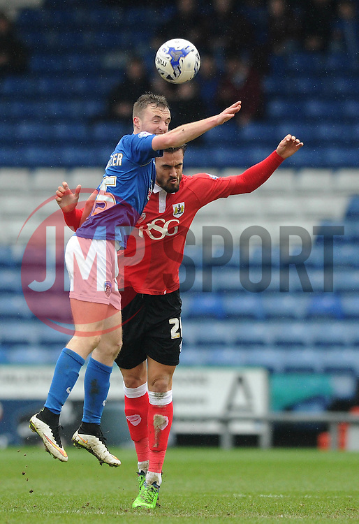 Oldham Athletic's Carl Winchester challenges for the header with Bristol City's Marlon Pack - Photo mandatory by-line: Dougie Allward/JMP - Mobile: 07966 386802 - 03/04/2015 - SPORT - Football - Oldham - Boundary Park - Bristol City v Oldham Athletic - Sky Bet League One