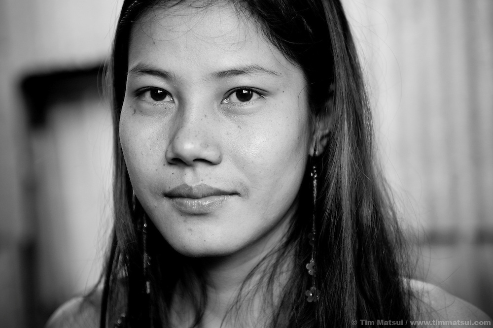 "Leena, a prostitute living in a slum where ""Acting for Women in Distressing Situations"" (AFESIP) conducts outreach and provides services, in Phnom Penh, Cambodia. The slum's permanent structure, a decaying four story building known simply as 'The Building', was built in the 1960's as transitional housing and now hosts a shantytown where many of the city's poor live, including many prostitutes, and is believed to have the highest rate of HIV infection in the city. AFESIP hands out free condoms, instructs prostitutes on HIV prevention, and conducts outreach in case the prostitutes need medical services, choose to leave their profession, or can report on cases of sex trafficking. AFESIP offers housing, education, training, and counseling for women who are victims of sex trafficking, worked as prostitutes, or are escaping domestic violence. Founded by Somaly Mam, who herself was once a prostitute and victim of trafficking and domestic abuse, AFESIP has three facilities in Cambodia and works with other NGO's to provide long term care for the women."