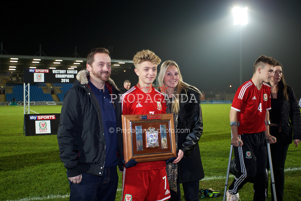 BALLYMENA, NORTHERN IRELAND - Thursday, November 20, 2014: Wales' Keiron Proctor with his parents after winning the Victory Shield with a 2-0 win over Northern Ireland during the Under-16's Victory Shield International match at the Ballymena Showgrounds. (Pic by David Rawcliffe/Propaganda)