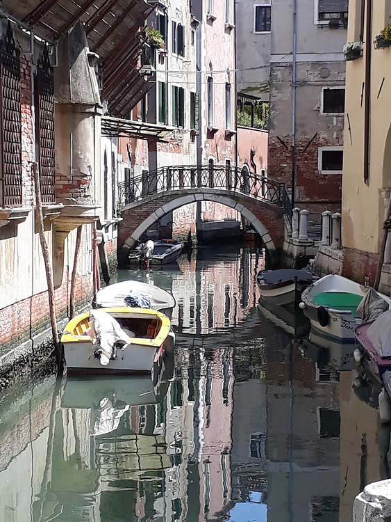 Venice Italy side canal with boats