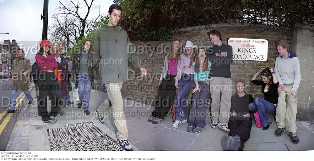 kingsrdsignwalkingpast<br /> King's Rd. London. Feb 2000<br /> © Copyright Photograph by Dafydd Jones 66 Stockwell Park Rd. London SW9 0DA Tel 0171 733 0108 www.dafjones.com