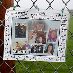"A makeshift memorial is seen outside Marysville-Pilchuck High School the day after a school shooting in Marysville, Washington October 25, 2014. Relatives of a Washington state teen accused of a high school shooting rampage said on Saturday that they were living in a ""nightmare"" and struggling to understand why the boy targeted his two cousins and several friends before killing himself. One girl was killed and four other freshman students were severely wounded in Friday's morning rampage inside the cafeteria at Marysville-Pilchuck High School, north of Seattle. REUTERS/Jason Redmond (UNITED STATES - Tags: CRIME LAW SOCIETY EDUCATION)"