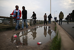 October 24, 2016 - Calais, Calais, France - Calais , France . People leave the Jungle migrant camp in Calais , Northern France , on the day of a planned eviction and start of the destruction of the camp  (Credit Image: © Joel Goodman/London News Pictures via ZUMA Wire)