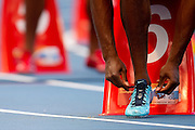 LaShawn Merritt from USA ties shoelaces before start in men's 400 meters qualification during the 14th IAAF World Athletics Championships at the Luzhniki stadium in Moscow on August 11, 2013.<br /> <br /> Russian Federation, Moscow, August 11, 2013<br /> <br /> Picture also available in RAW (NEF) or TIFF format on special request.<br /> <br /> For editorial use only. Any commercial or promotional use requires permission.<br /> <br /> Mandatory credit:<br /> Photo by &copy; Adam Nurkiewicz / Mediasport