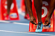 LaShawn Merritt from USA ties shoelaces before start in men's 400 meters qualification during the 14th IAAF World Athletics Championships at the Luzhniki stadium in Moscow on August 11, 2013.<br /> <br /> Russian Federation, Moscow, August 11, 2013<br /> <br /> Picture also available in RAW (NEF) or TIFF format on special request.<br /> <br /> For editorial use only. Any commercial or promotional use requires permission.<br /> <br /> Mandatory credit:<br /> Photo by © Adam Nurkiewicz / Mediasport
