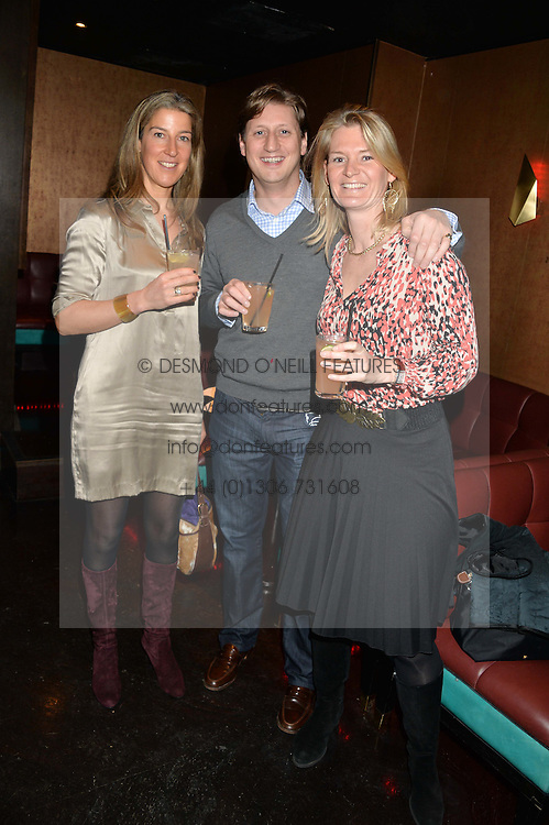 Left to right, ANNABEL POPE, JAMES GRANT and OLIVIA SUTCLIFF at a party in aid of the Youth at Risk charity held at Raffles, 287 King's Road, London on 27th November 2013.
