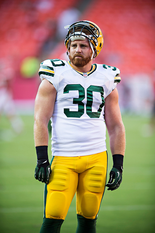 KANSAS CITY, MO - AUGUST 29:  John Kuhn #30 of the Green Bay Packers warms up before the last preseason game against the Kansas City Chiefs at Arrowhead Stadium on August 29, 2013 in Kansas CIty, Missouri.  (Photo by Wesley Hitt/Getty Images) *** Local Caption *** John Kuhn