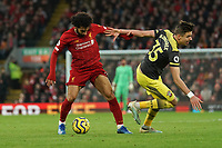 Football - 2019 / 2020 Premier League - Liverpool vs. Southampton<br /> <br /> Liverpool's Mohamed Salah under pressure from Southampton's Jan Bednarek<br /> <br /> Colorsport / Terry Donnelly