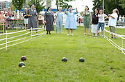Sisters of Charity of St. Joan Antida and St. Joan Antida High School alumna react during a bocce ball tournament held during the St. Joan Antida High School reunion July 22 at the Henry Meier Festival Grounds in Milwaukee. The girls' high school, sponsored by the Sisters of Charity, holds its annual reunion during Festa Italiana. The bocce tournament pits St. Joan Antida faculty and alumna against the sisters. (Photo by Sam Lucero).