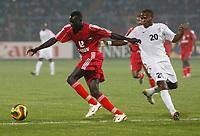 Photo: Steve Bond/Richard Lane Photography.<br />Sudan v Zambia. Africa Cup of Nations. 22/01/2008. Eldoud Badr Eldin (L) keeps the ball away from Felix Katongo (R)