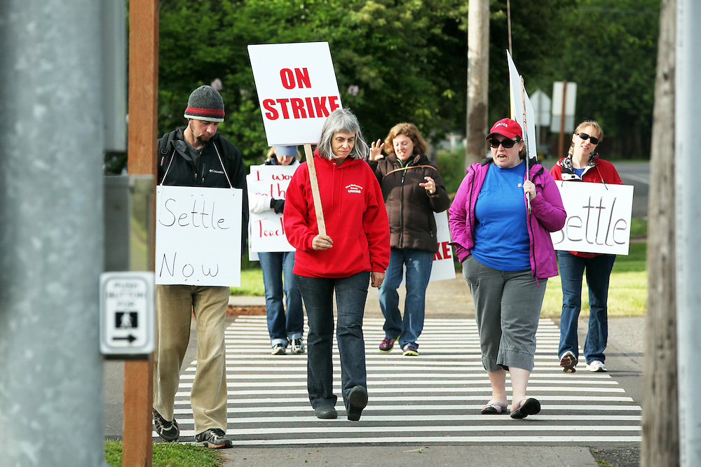 Teachers and staff go on strike at Reynolds Middle School on Friday, May 25, 2012.